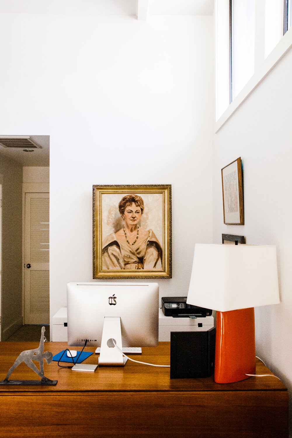 We chose to hang a portrait of her grandmother (grandma, right?) behind Annie's desk in a prominent position. Grandma is also facing the portrait of baby Annie that is nestled on the small wall to the left of the sliding glass doors (pictured above).