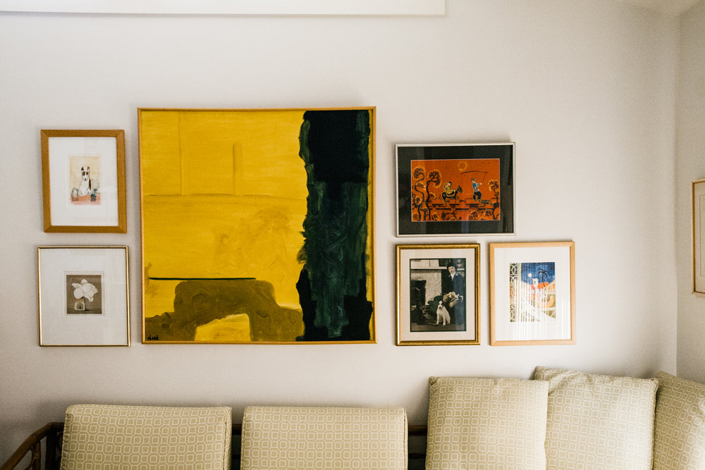 We created a gallery wall around the large beautiful yellow painting done by her husband.