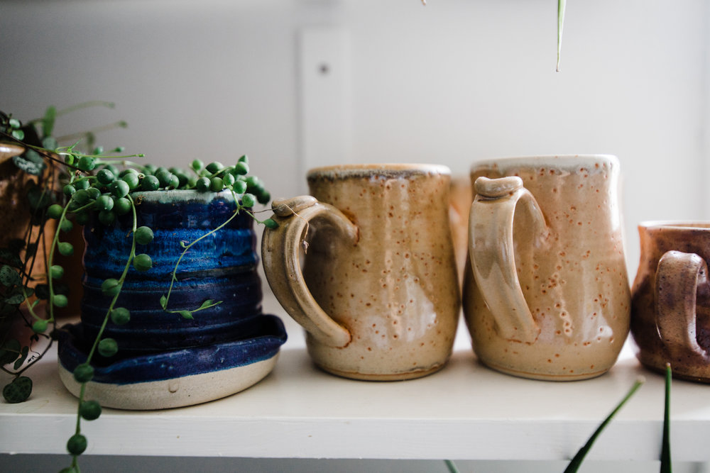 Daly got herself a set of custom made  Foxy Pots  mugs, and drinking coffee (Any beverage really–I sipped soup from one last week.) has never been so happy. Look at that peachy, shiny goodness. That blue pot is Foxy Pots too. We carry her planters in the shop! All the heart eyes.