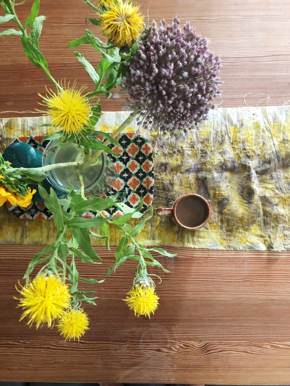 The table runner I made at House Sparrow's plant dyeing workshop last week makes me smile when I catch a glimpse of it during the day. Also, my Foxy Pots mug is a nice companion to it. PS I need to wax my table to get rid of those rings! Ha. -Palmer