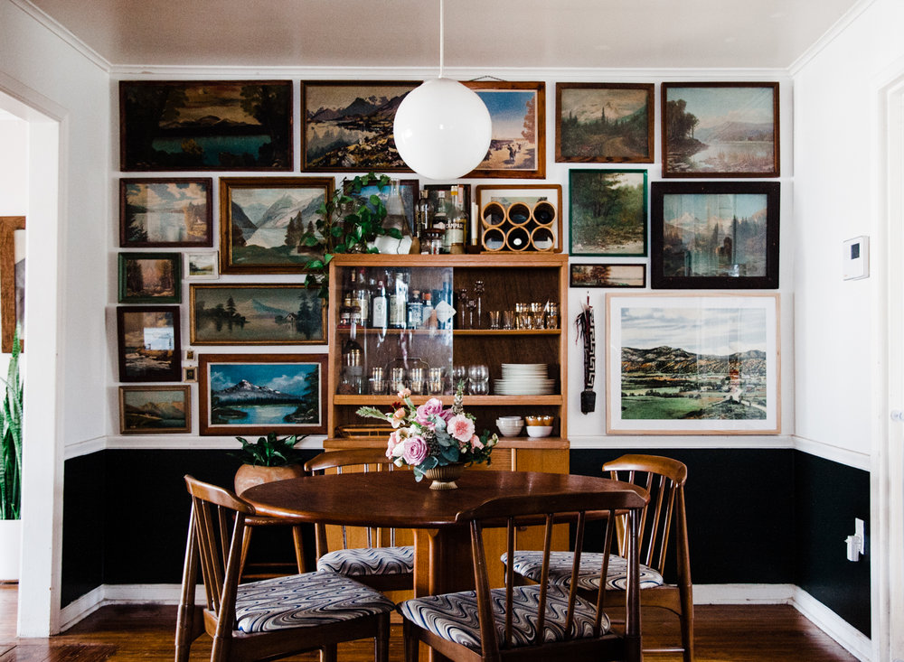 For Daly's    dining room landscape gallery wall   , she stuck to simple wooden frames with varying wood tones (and a few painted ones in there!).