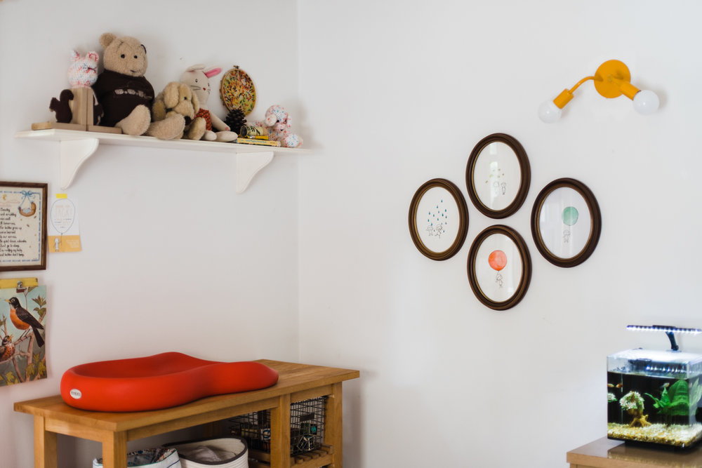 Palmer has a similar look in    her shared kids' room   . Simple dark wooden frames in various shapes are found here.