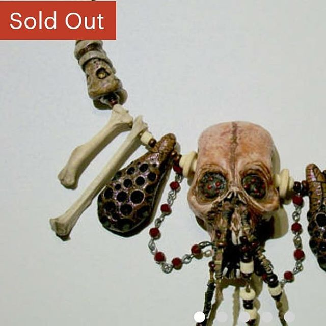 #zombieheadjewelry #Zombiehead #voodoojewelry #voodooskull #skulljewelry #skull #tribaljewelry #bonejewelry #horrorfashion #horroraccessories #horrorjewelry #handmadebeads #creepyart #creepybohemian #creepyjewelry #orlandoartists #Krystalosborne #oddityjewelry #morbidjewelry #piratejewelry