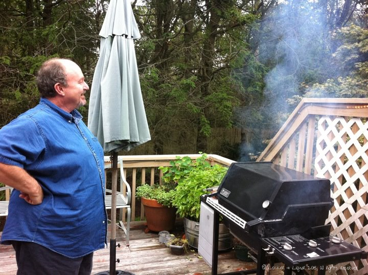 Harry surveying his backyard kingdom and charring off the Weber in preparation for that evening's braai; he and Carolyn have since moved across the country and I miss them terribly.