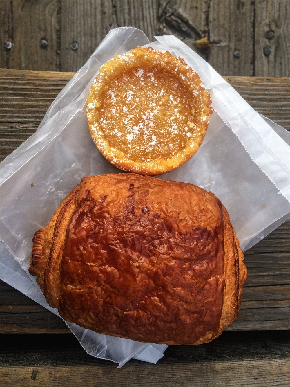 Standard Baking Co.'s lemon tart and pain au chocolat.