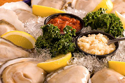Your choice how to enjoy them - served raw on the half shell, lightly battered and fried or grilled with garlic butter and a little parmesan. Freshly shucked Gulf Coast oysters are a Razzoo's favorite.