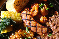 Not sure what to try? Sample a bit of everything with the Cajun Combo Skillet. Crawfish Etoufee, Shrimp Creole, Red Beans & Rice and grilled Andouille Sausage served in a cast iron skillet.