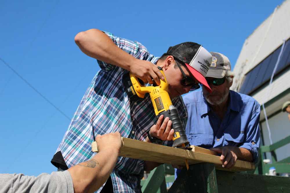 Trent Williams (left), a member of the Tule River Tribe, gains hands-on experience with installing solar energy with one the pioneers of the field, Johnny Weiss (right).