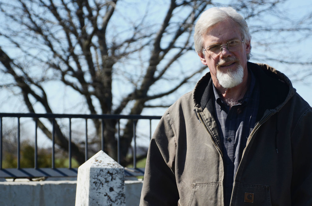 David Snyder, the owner of Jacob's Ladder Cemetery Restoration Specialists, looks over his handiwork at the McHargue Cemetery near Salisbury, Missouri, on Monday, March 21, 2016. He fully restored the burial site, transforming it from a few scattered stones into a peaceful resting place atop a hill.