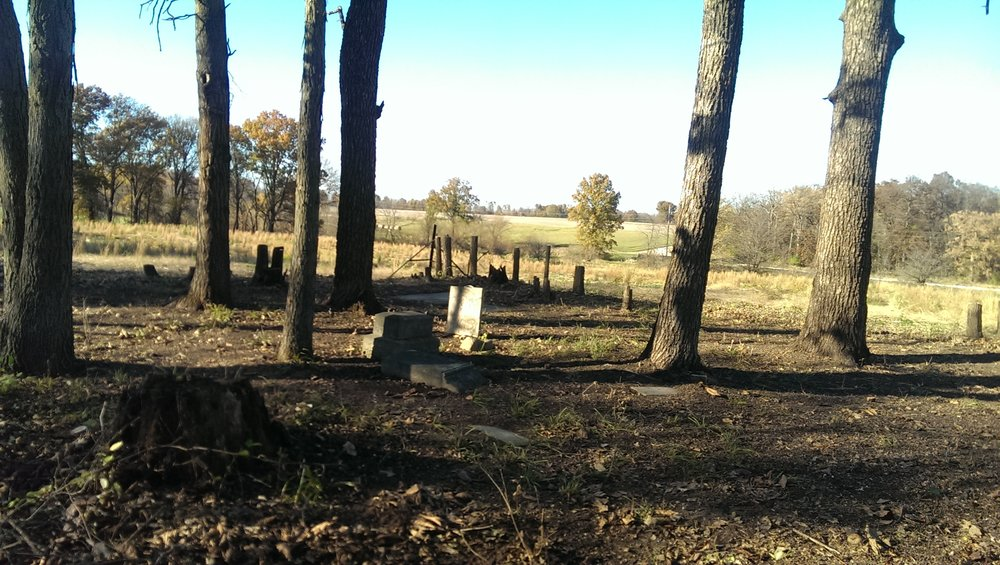 Randy Dent's family cemetery outside of Kirksville, Missouri, stands revealed after he cleared away tree and debris in this undated photo. Photo Courtesy Randy Dent.