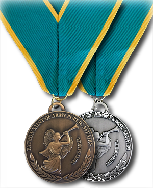 The medallion for the Honorable Order is brushed silver; the Ancient Order medallion is brushed gold. The front of the medallion features an image of Saint Gabriel sounding good news with his trumpet. The reverse has the familiar Public Affairs emblem with crossed sword, pen and lightning bolt signifying the diverse roles in Army Public Affairs.