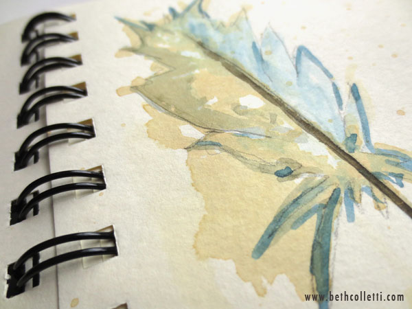 Feather painted with watercolor and tea.