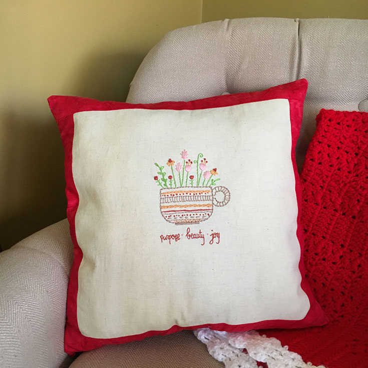 The finished pillow gift with the Herbal Tea embroidery pattern!