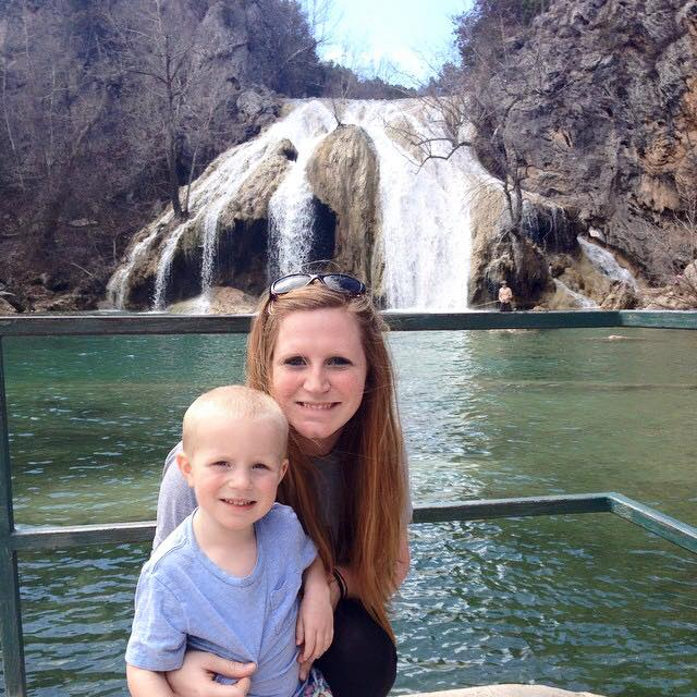 Family Enjoying a Day at Turner Falls Park in From of Oklahoma's Largest Waterfall.