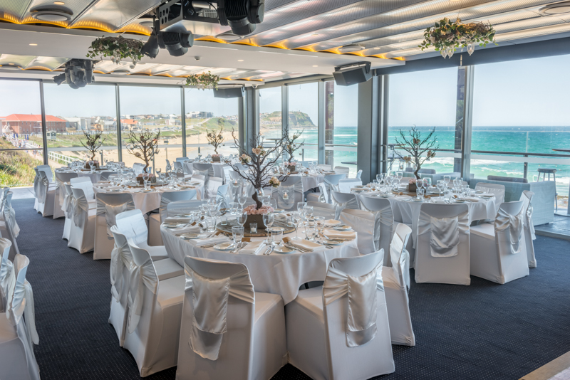 Elegant Newcastle wedding reception with ocean views.