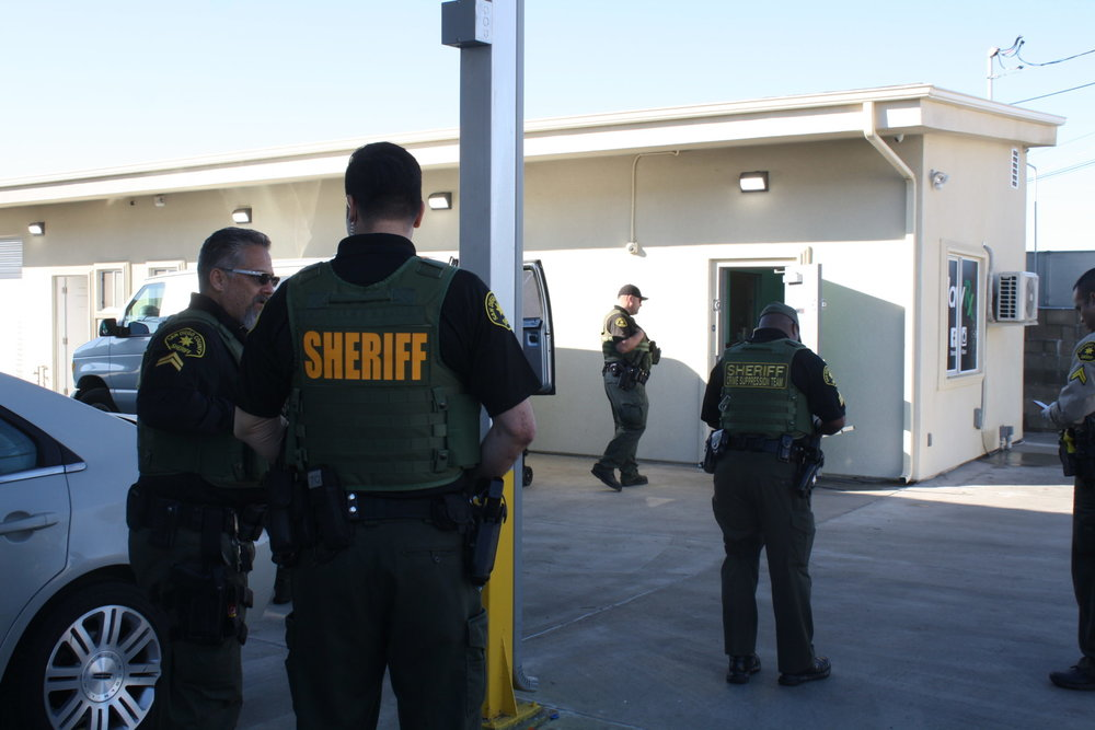 San Diego County Sheriff's Department deputies raid an illegal dispensary in Spring Valley. / Photo by Kinsee Morlan