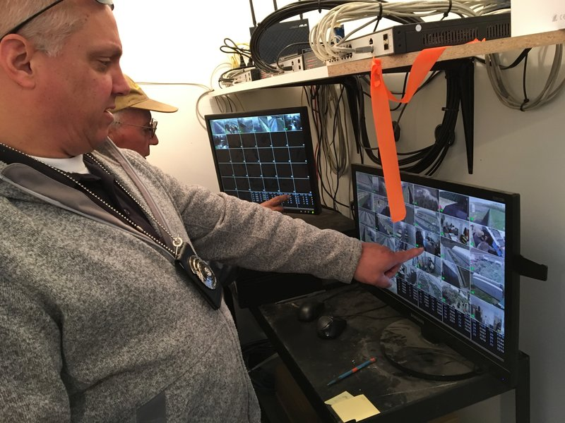 Officer Steve Morehead, of the Washington State Liquor and Cannabis Board, does a spot check on the required video surveillance system at a licensed pot grower near Brewster, on the Columbia River.