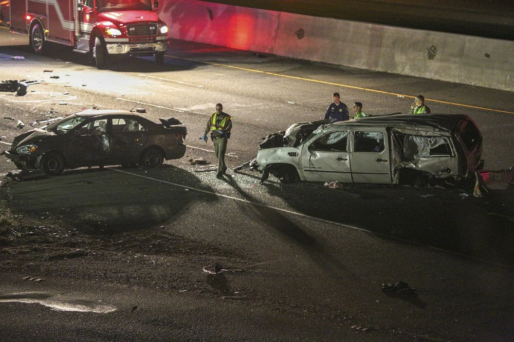 California Highway Patrol officers investigate the scene of a multi-car crash on Interstate 880 in Fremont, Calif. Several people were killed in a multi-car crash that closed several lanes of a major San Francisco Bay highway and officials say the driver suspected of causing it was under the influence of marijuana.