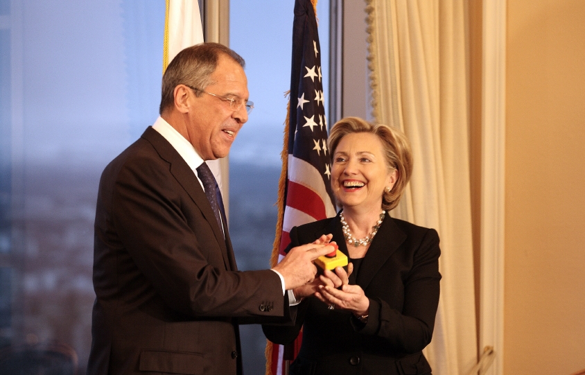 Sergey Lavrov and Hillary Clinton push the button. SOURCE: US State Department, Public Domain