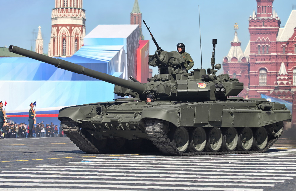 A Russian T-90 rolls through Moscow during May Day 2013. Photo Copyright    Vitaly V. Kuzmin  , Used under  Creative Commons License  .