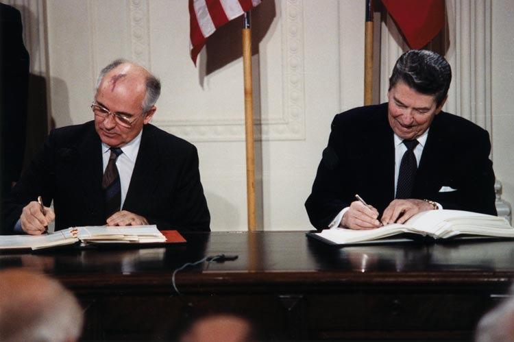 """Reagan and Gorbachev signing"" by White House Photographic Office - National Archives and Records Administration ARC Identifier 198588, courtesy Ronald Reagan Presidential Library:Source URL: http://www.reagan.utexas.edu/archives/photographs/large/c44071-15a.jpg"