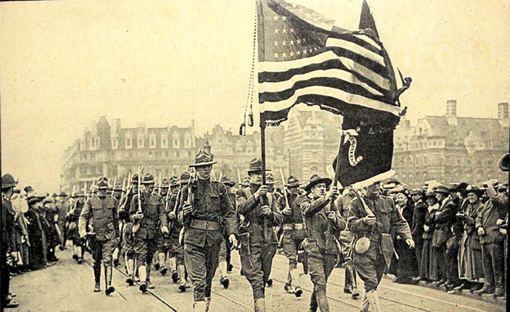 Members of the American Expeditionary Force March in Paris. Image: Public Domain.