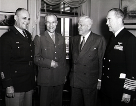 General Matthew Ridgway asks Secretary Wilson to remove the knife from his back...Pictured: GEN Matthew Ridgway, French GEN Paul Ely, Secretary of Defense Charles Wilson and ADM Arthur Radford, 22 March 1954 (Public Domain).