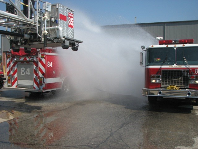 Figure 6 - A Mass Decontamination set up with two pumper trucks and an aerial spray. (Source: Village of Palatine, Illinois)