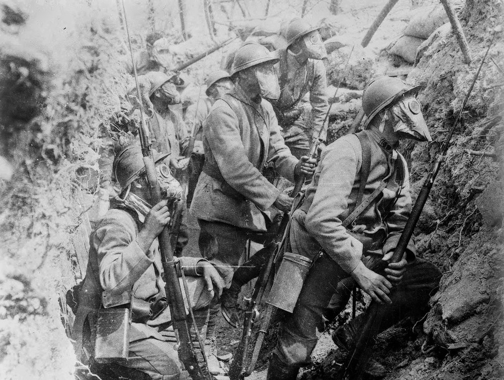 French Soldiers man a trench wearing their M-2 Masks