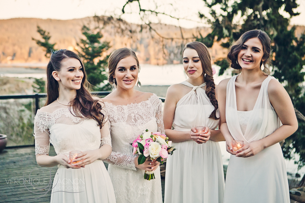 Bride and bridesmaids in all in cream with pastel accents
