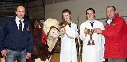 Stephen Buick presents the Bruces Hill Perpetual Cup for the supreme champion to first-time exhibitor Stephen Millar, Newtownstewart. Included are handler Jack Smyth, and judge Thomas Hamilton, Dungannon