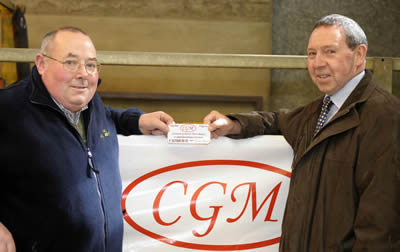 Pat Kelly pictured with Johnny Connon, from Connon General Merchants, Ballymoney who kindly sponsored a voucher for the farmer spending the most in the commercial section.