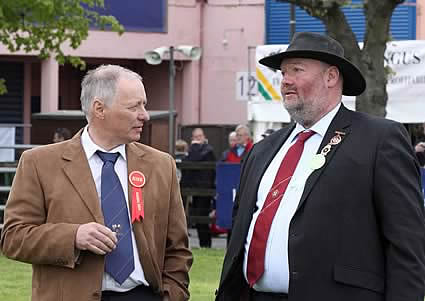 Balmoral Simmental judge Bertie Houston with chief steward Jay Lindsay.