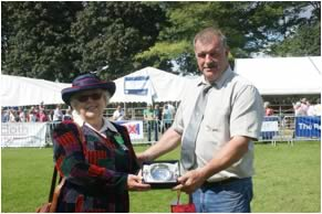 Club Chairman Tom Henderson, presents a Quaich to Judy for Judging the Show