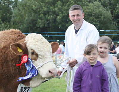 William, Kaitlyn and Emma Whyte, Portglenone, with their reserve Simmental champion at Antrim Show