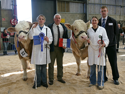 From Left to Right Judge, Mr Ian Malcolm pictured with Champion Bull Lot 50 Halenook Topper, Reserve Champion Lot 52 Corskie Theo and Sponsor from Fraser Tennant