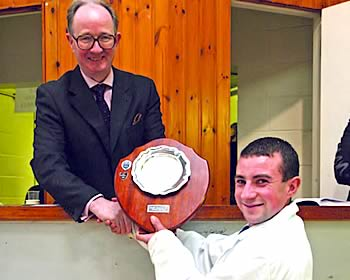 Douglas Smith receiving the Young Stockperson of the Year award at Perth Bull Sales in November from sponsor David Leggat MBE, United Auctions.