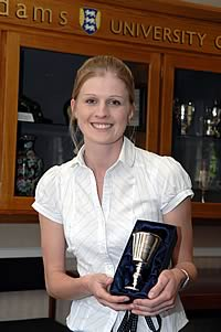 Abigail with a replica of her award