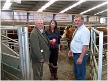 Hector Macaskill receives his prize for best SimmentalX heifer with calf at foot from Hilary Bennie of Sponsors Carrs Billington and Tom Henderson, Club Chairman