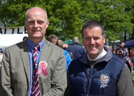 Lurgan Show Simmental judge Michael Robson, with NI club secretary Robin Boyd, Portglenone.