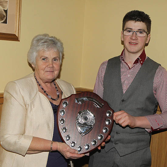 Thelma Gorman congratulates Jamie Boyd, Portglenone, winner of the Young Stockperson of the Year Award.