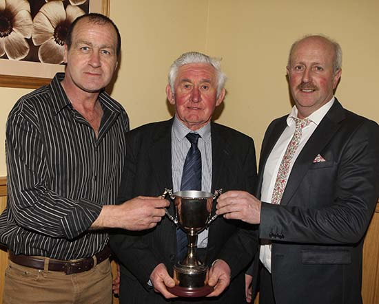 Willie Phair, Lisbellaw, receives the Bruces Hill Trophy for the champion at the autumn show and sale from sponsor Stephen Buick, and club chairman Nigel Glasgow.