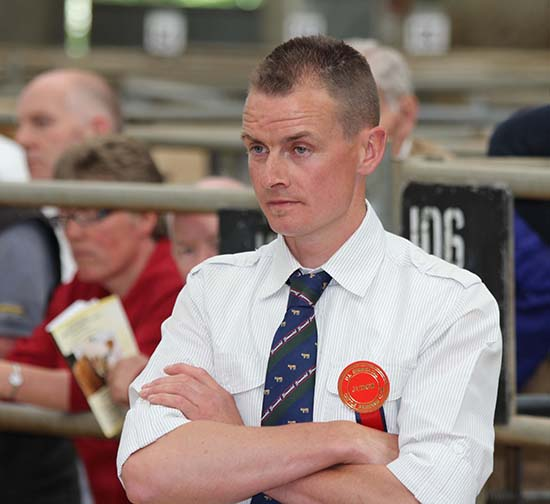 Simmental Club chairman Richard Rodgers, Portglenone, judged its evening show and sale at Ballymena Mart.