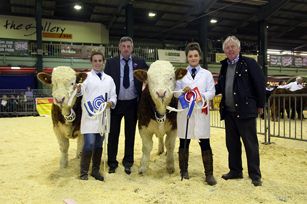 Champion Bull Calf sired by a Pedigree Simmental Bull - Popes Freeman 14 with Hannah Wood, Reserve Champion Bull Calf sired by a Pedigree Simmental Bull - Popes Foreman 14 with Hannah Brown,  Judge Charlie Collison and Society President David Donnelly
