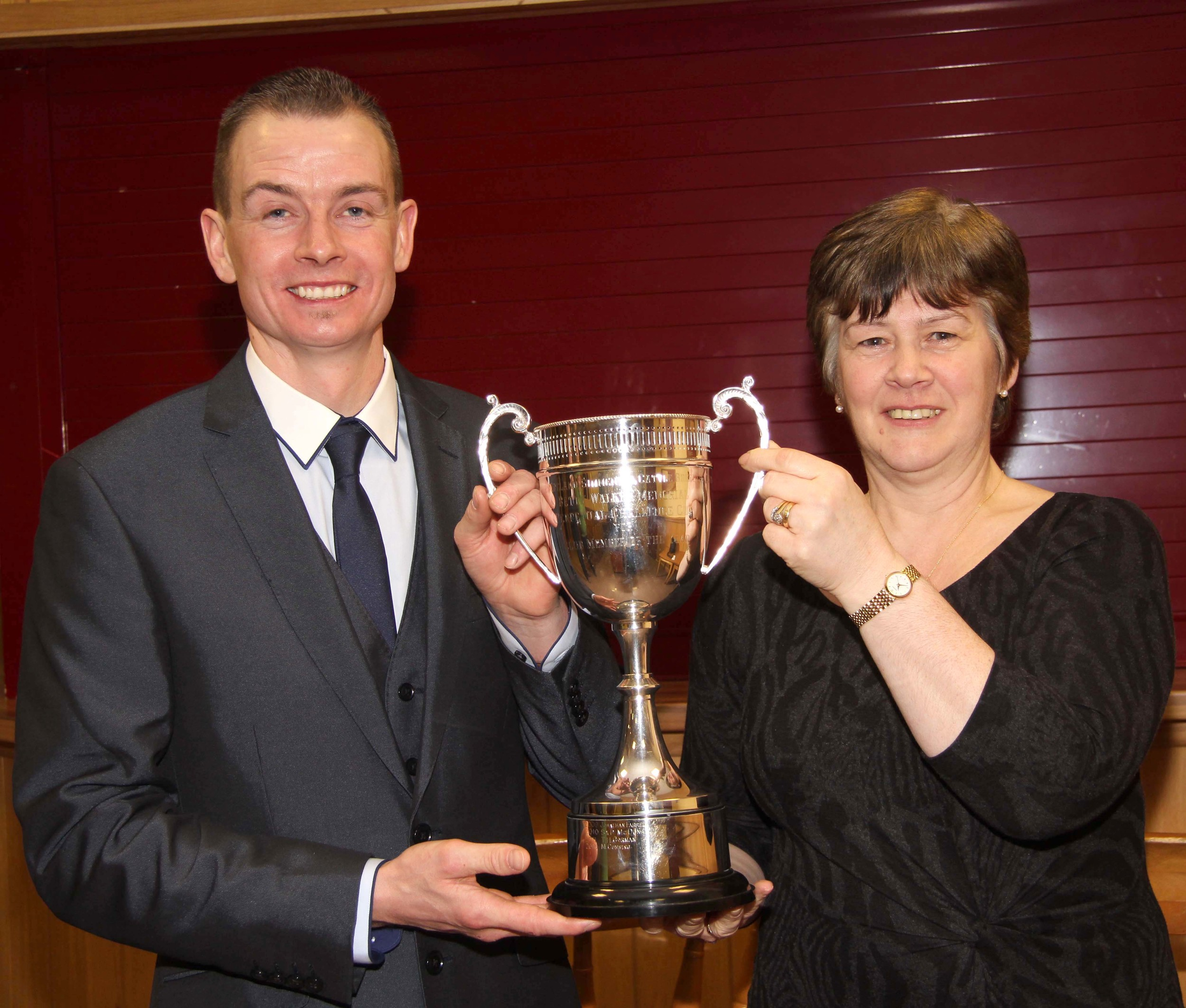 Club Member of the Year Darla Boyd, Portglenone, receives the Betty Walker Memorial Trophy from chairman Richard Rodgers.