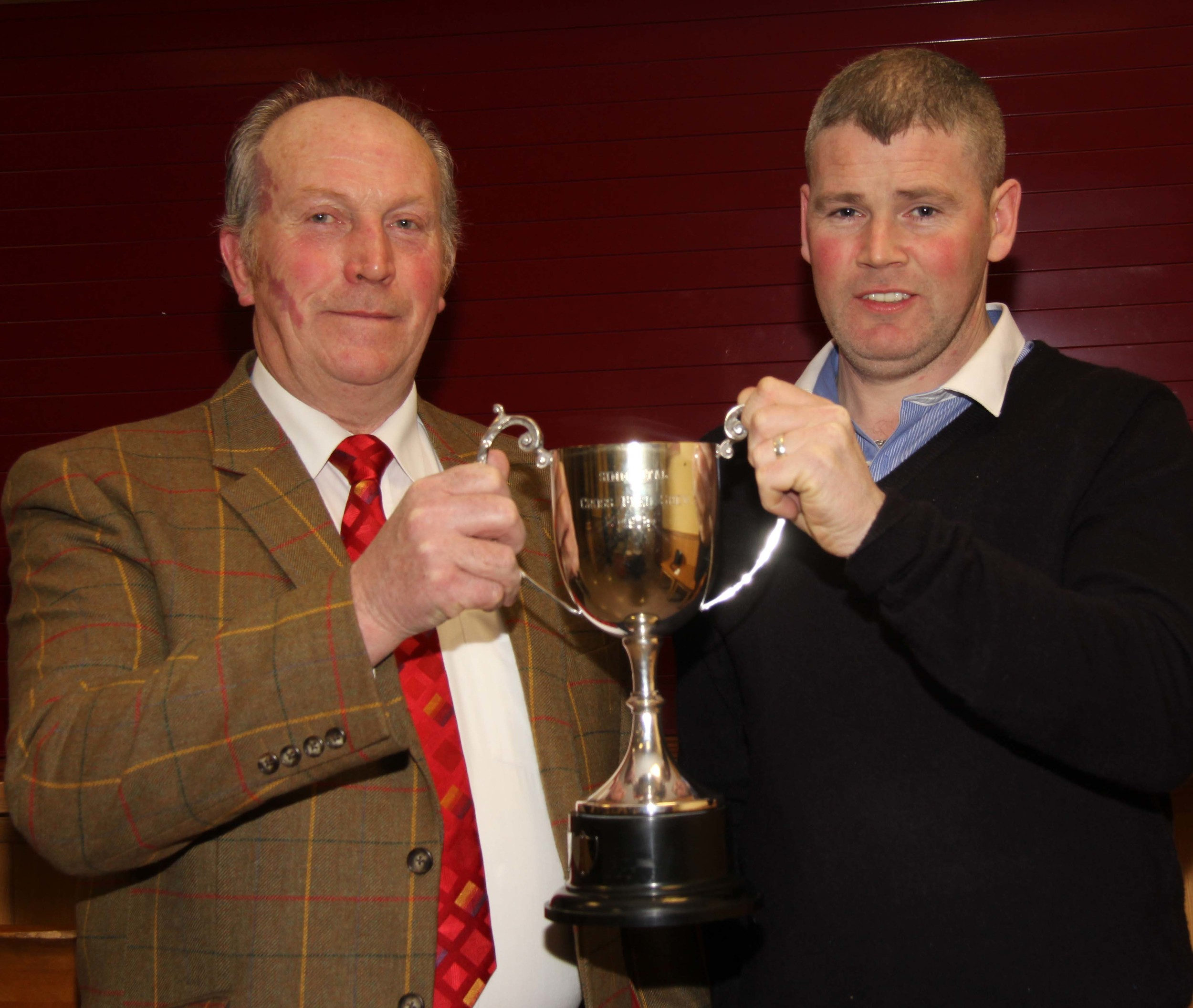 Joe Wilson, Newry, won the Woodcraft Kitchens Junior Heifer Derby. He received his award from sponsor Eamon McCloskey.