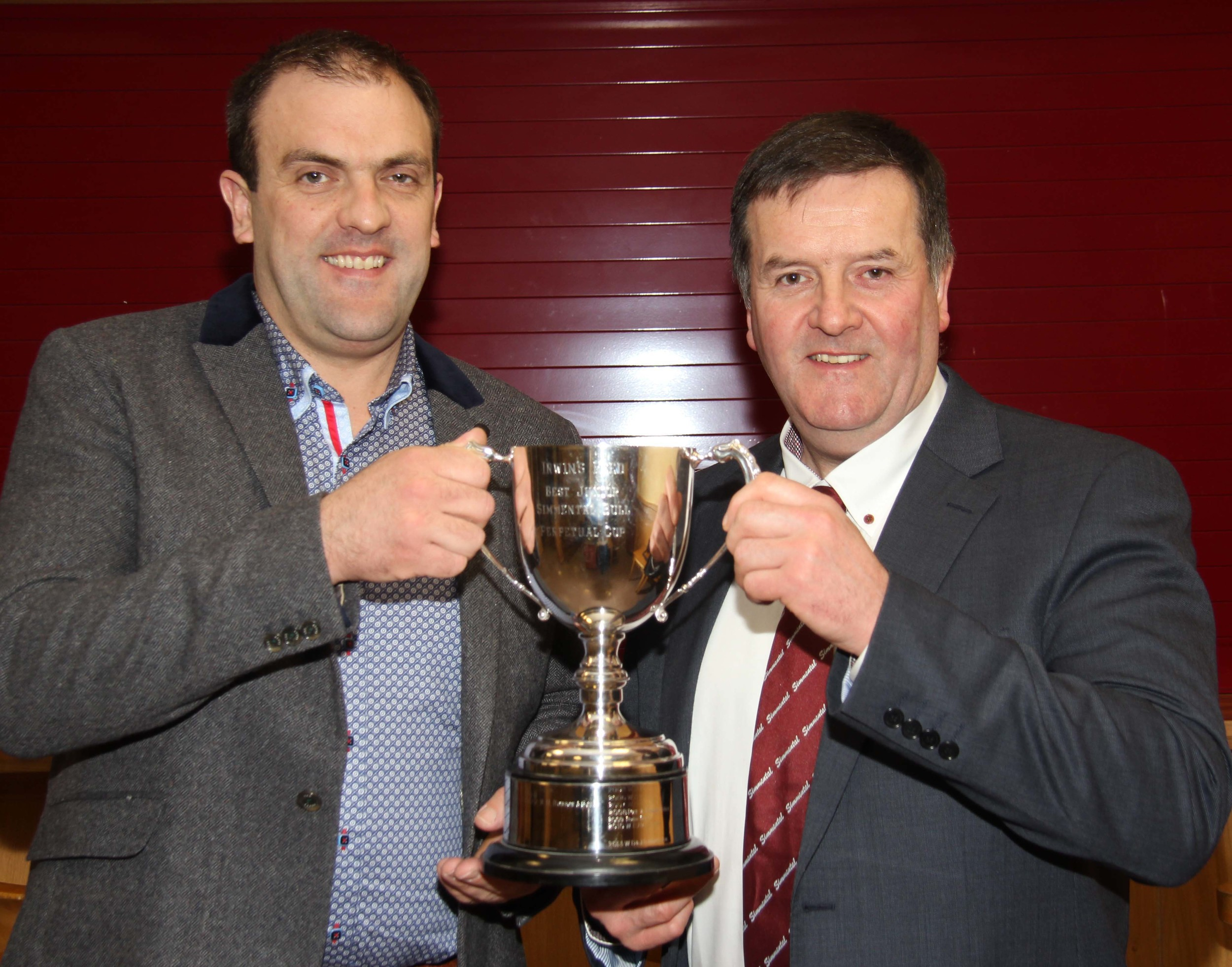 Robin Boyd receives the Irwins Feeds cup for the best junior bull at Clogher Show on behalf of Duncan McDowell, Newtownards, from sponsor Ian Cummins.