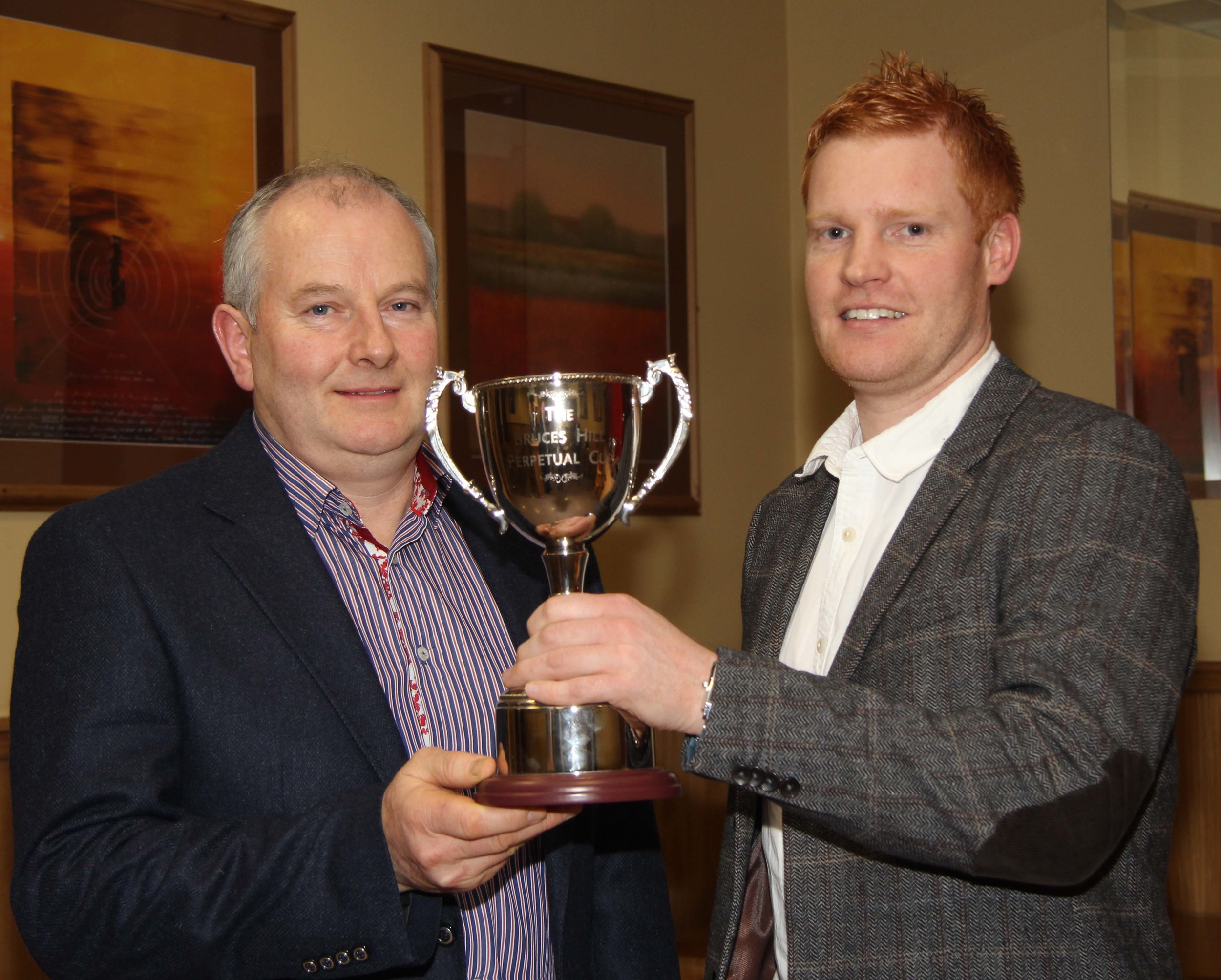 Francis Connon, Connon General Merchants, presents the trophy for the champion at the May show and sale to Christopher Weatherup, Ballyclare.