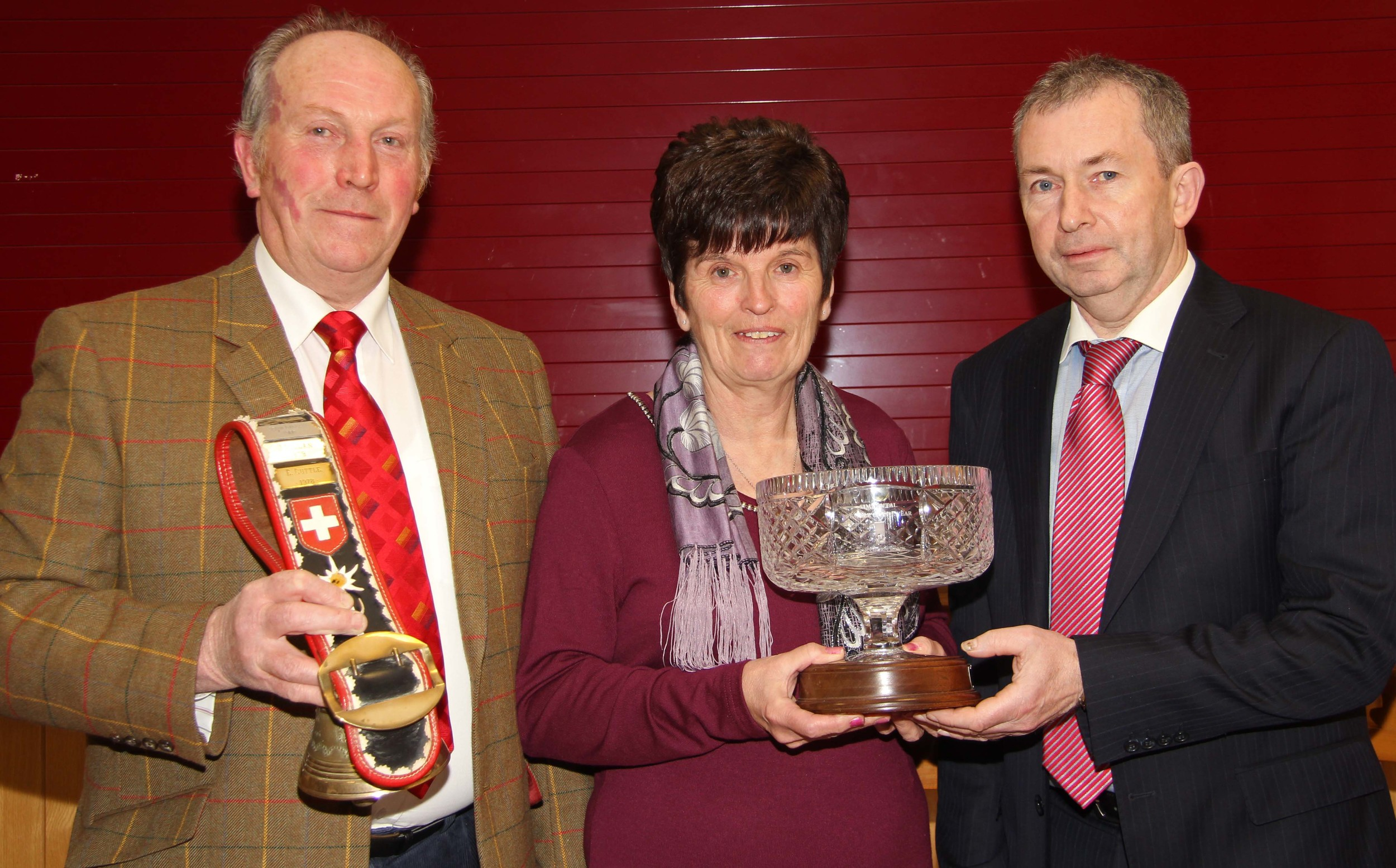 Joe and Phyllis Wilson, Newry, receive the female of the year award from Andrew Tecey, Dankse Bank, at the NI Simmental Club's annual dinner, Dungannon.
