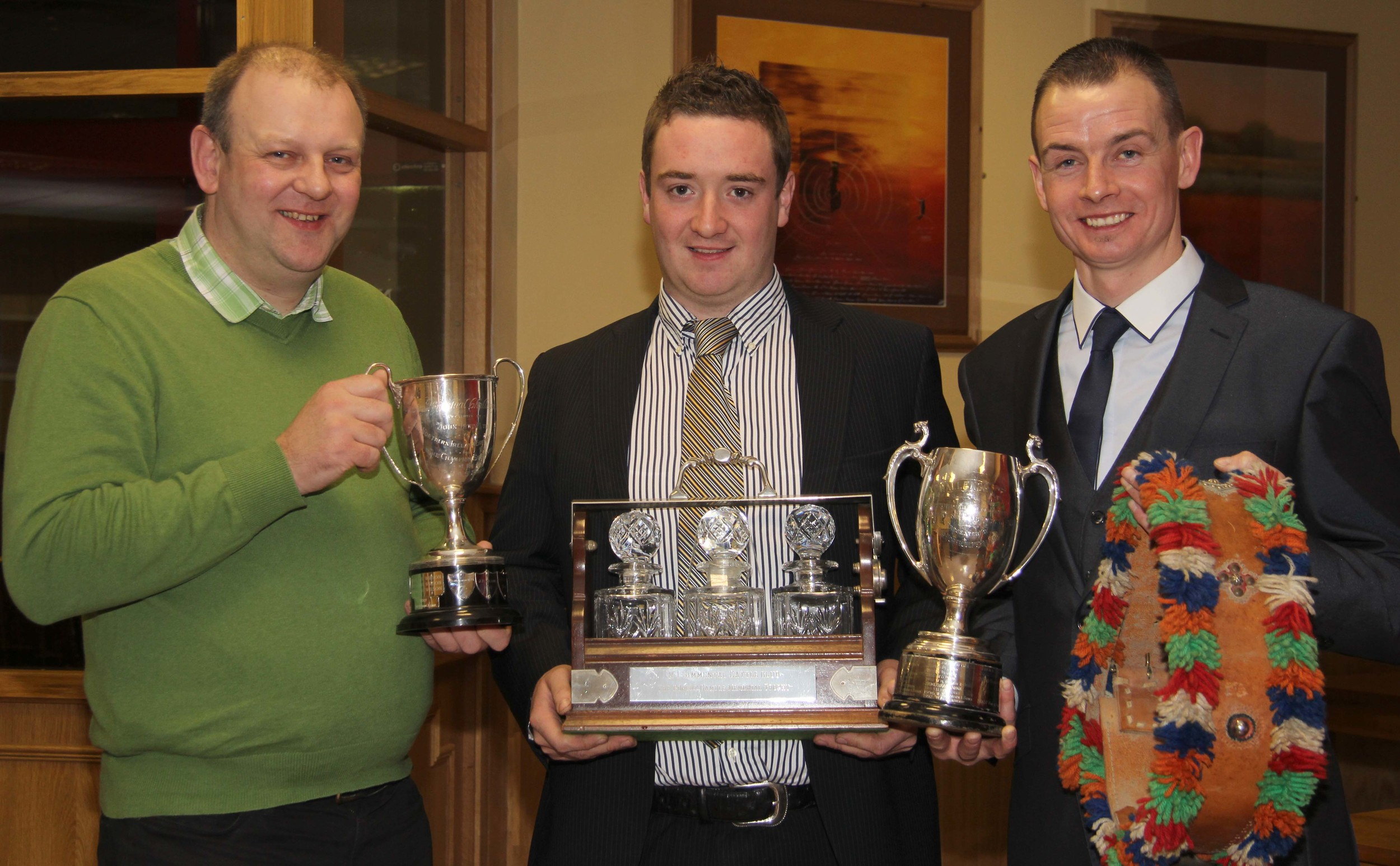 Marcus Berry, centre, receives an array of trophies on behalf of Noel and Mai Kilpatrick, Banbridge, at the NI Simmental Club's annual dinner. He was congratulated by vice-chairman Matthew Cunning, and chairman Richard Rodgers.